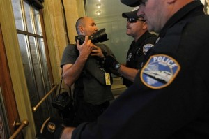 Police officers eject NY Times photographer Robert Stolarik from Grand Central Station in New York