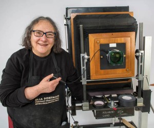 Photographer Elsa Dorfman with her 20x24 Polaroid camera in her studio. (Jesse Costa/WBUR)